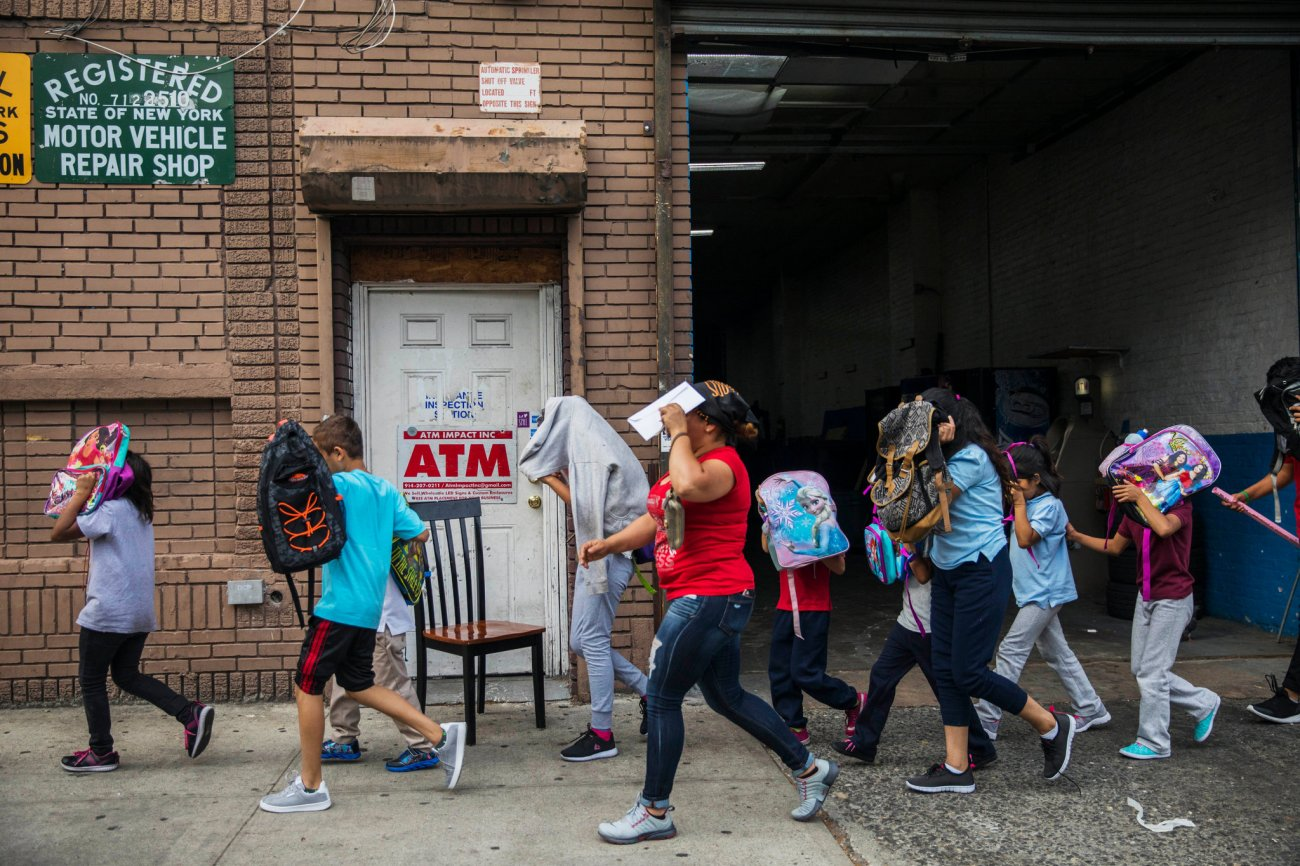 Children left the Cayuga Centers in Harlem on Wednesday. The shelter, which is working with children separated from their parents at the border, runs several programs. The Times could not independently verify which of the children were in programs for those separated from their parents. Credit: Hiroko Masuike/The New York Times